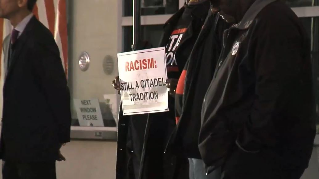 'Racism: Still a Citadel Tradition' sign at Steve Bannon counter rally (WCIV)