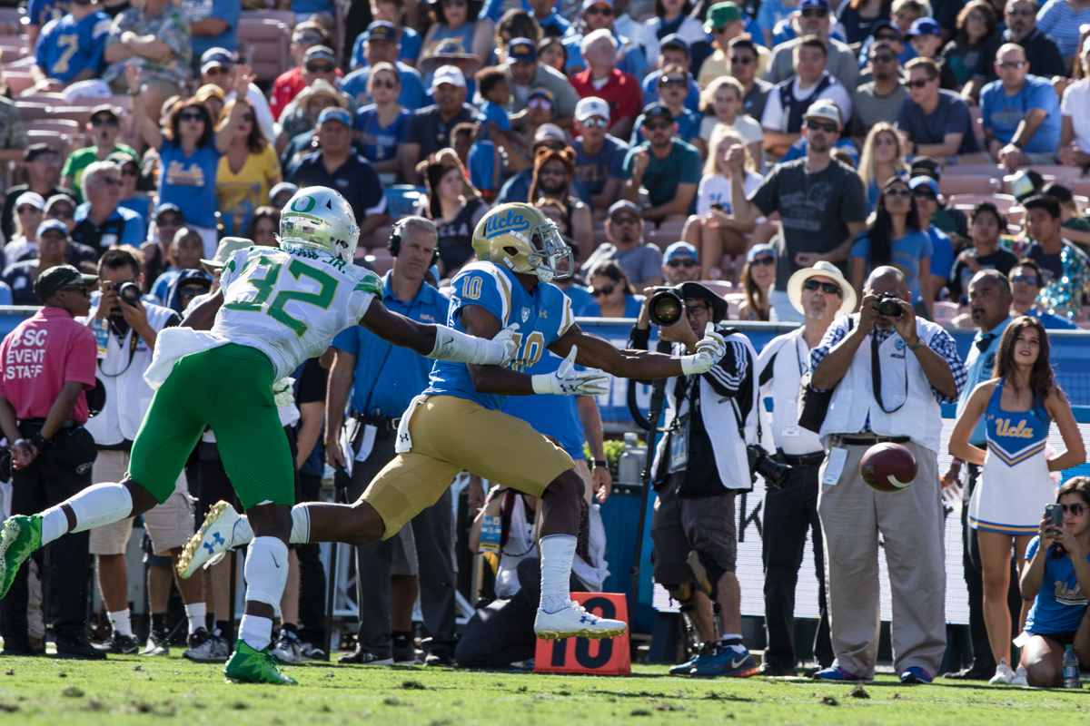 UCLA wide receiver Demetric Felton reaches for an overthrown pass while defended by Oregon linebacker La'Mar Winston Jr. The Oregon Ducks fell to the UCLA Bruins 14-31 after being shut out during the second half at the Rose Bowl Stadium in Pasadena, California.  This marks the third consecutive loss for the Ducks, dropping their record to 4-4 on the season.  Photo by Austin Hicks, Oregon News Lab