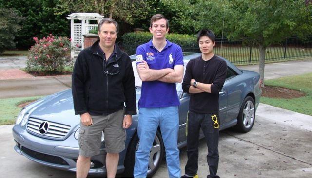 Dave Black, Ed Bolian and Dan Huang pose in front of the car they would use to attempt to break the record. Bolian is the leader and main driver, Black acted as the co-driver and Huang was the team's spotter.