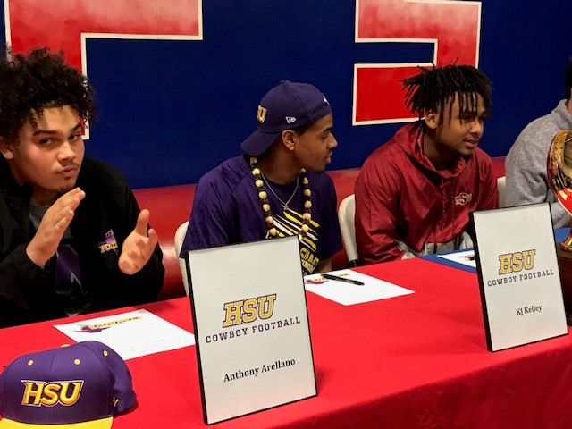 Anthony Arellano, KJ Kelley and Tyrees Whitfield of Abilene Cooper take part in signing cermonies.<p></p>