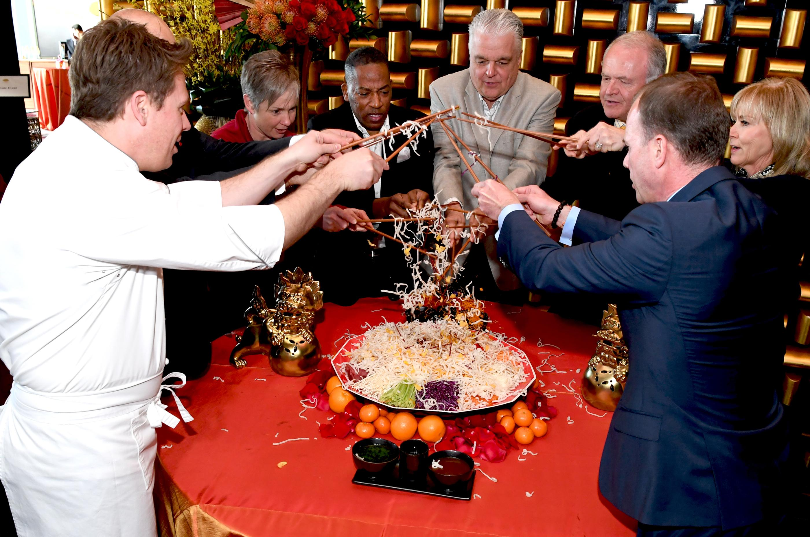 The Mandarin Oriental, Las Vegas celebrates the Chinese New Year, Year of the Dog with a special Yusheng Toss presentation. Pictured: (clockwise) David Werlyu (front left), Executive Chef Mandarin Oriental; Christopher Pageaud, Food and Beverage Director Mandarin Oriental; Ellen Charnley, wife of Donald Bowman; Lawrence Weekly, Clark County Commissioner; Steve Sisolak, Clark County Commissioner; Peter Sadowski, Executive Vice President and Chief Legal Officer for Vegas Golden Knights; Denise Decker-Sadowski, wife of Peter Sadowski; and Donald Bowman, General Manager Mandarin Oriental. Thursday, February 15, 2018. CREDIT: Glenn Pinkerton/Las Vegas News Bureau
