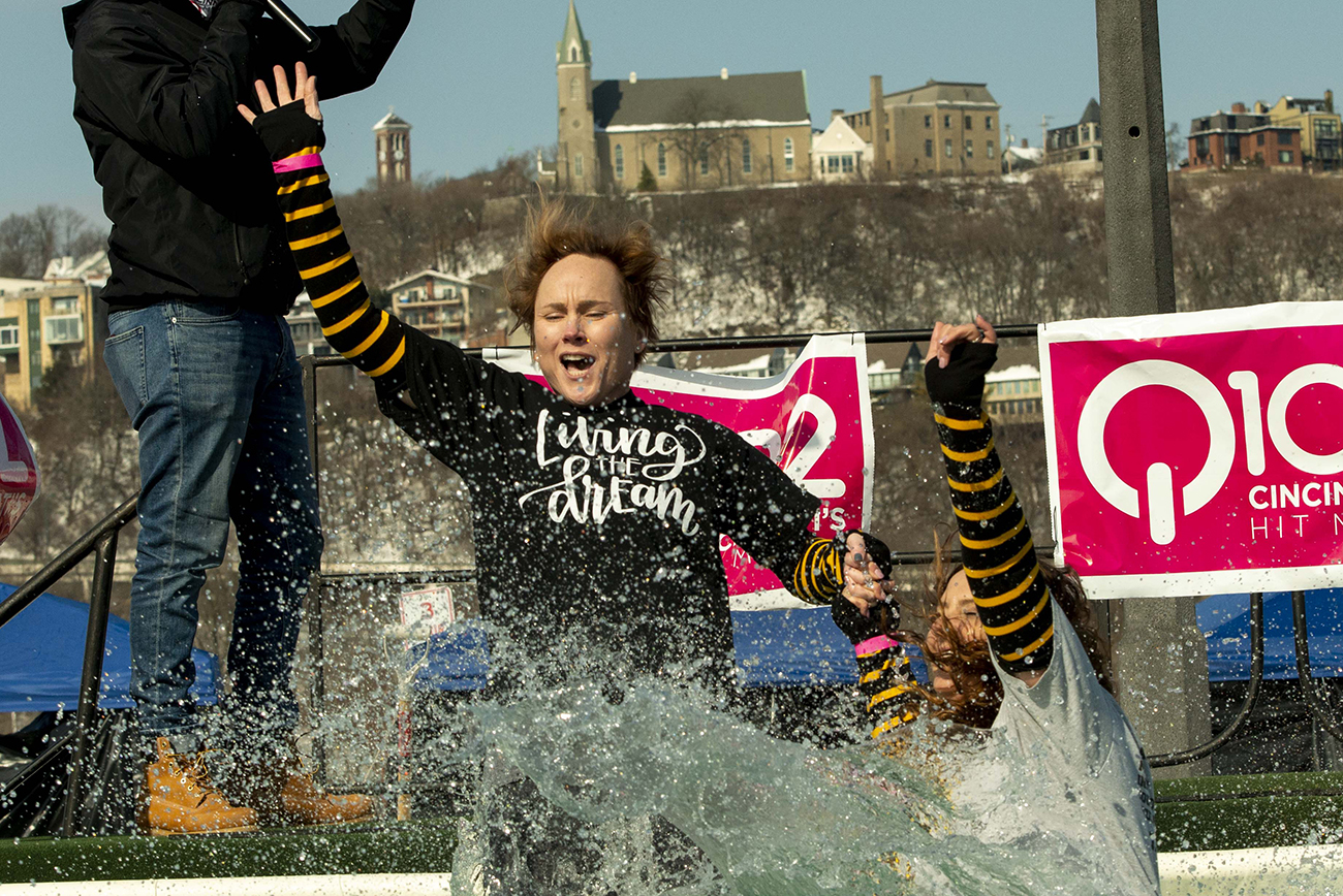 The 2021 Polar Plunge, a fundraiser for Special Olympics Kentucky and Ohio, took place on Saturday, February 20 at Buckhead Mountain Grill in Bellevue. Teams and individuals launched themselves into frigid water to raise over $70,000 this year. COVID-19 precautions were in place, spreading the crowd a little thinner than previous years. Many teams wore costumes to add a little extra fun to their jump, and awards for top fundraising team and best costumes were given out. / Image: Joe Simon // Published: 2.21.21
