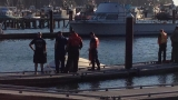 Coast Guard: Diver pulls boy, 6, from beneath capsized boat