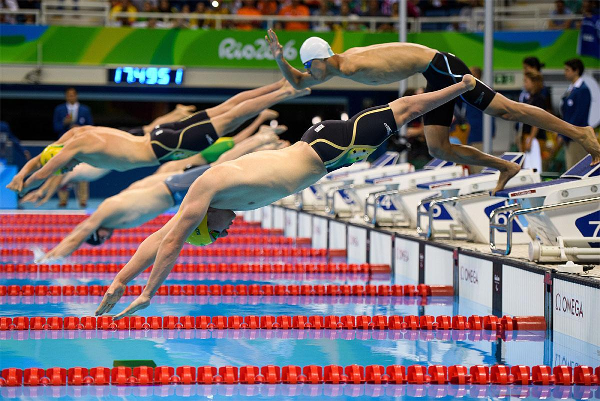 In this photo provided by the IOC, athletes dive into the pool for the final men's 400-meter freestyle S8 swimming event at the Olympic Aquatics Stadium during the Paralympic Games in Rio de Janeiro, Brazil, Thursday Sept. 8, 2016. (Bob Martin/OIS,IOC via AP)