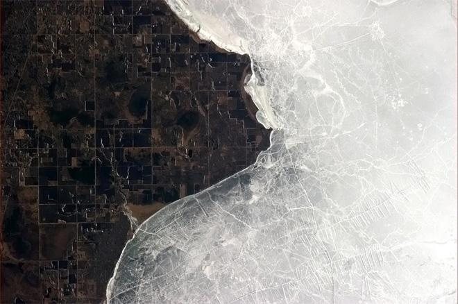 The yin and yang of ice and land at Lake of the Woods.  (Photo & Caption: Col. Chris Hadfield, NASA)