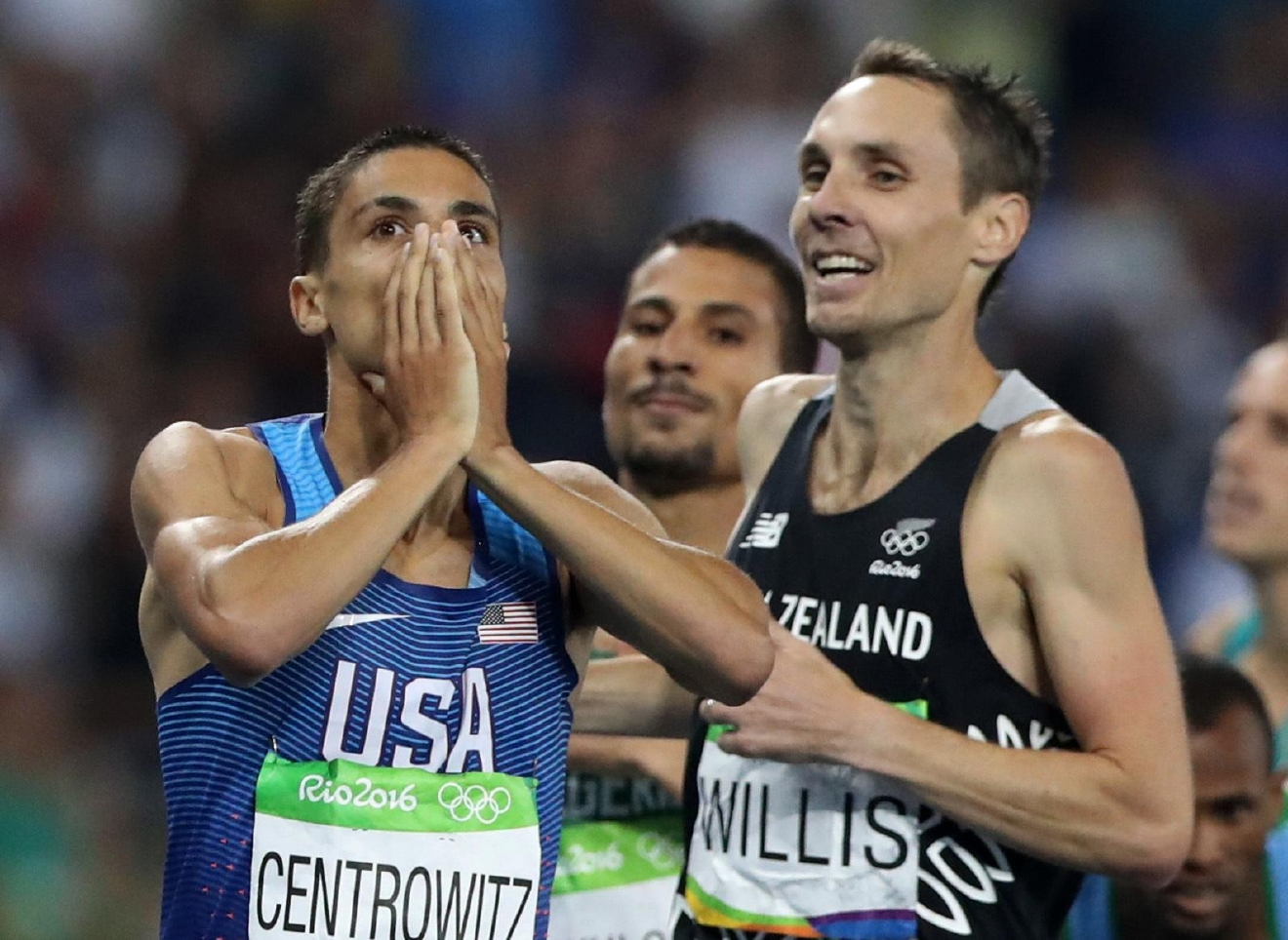 United States' Matthew Centrowitz, left, reacts to winning the gold after crossing the finish line with New Zealand's Nicholas Willis for the men's 1500-meter final at the athletics event during the Summer Olympics at Olympic stadium in Rio de Janeiro, Brazil, Saturday, Aug. 20, 2016. (AP Photo/Lee Jin-man)