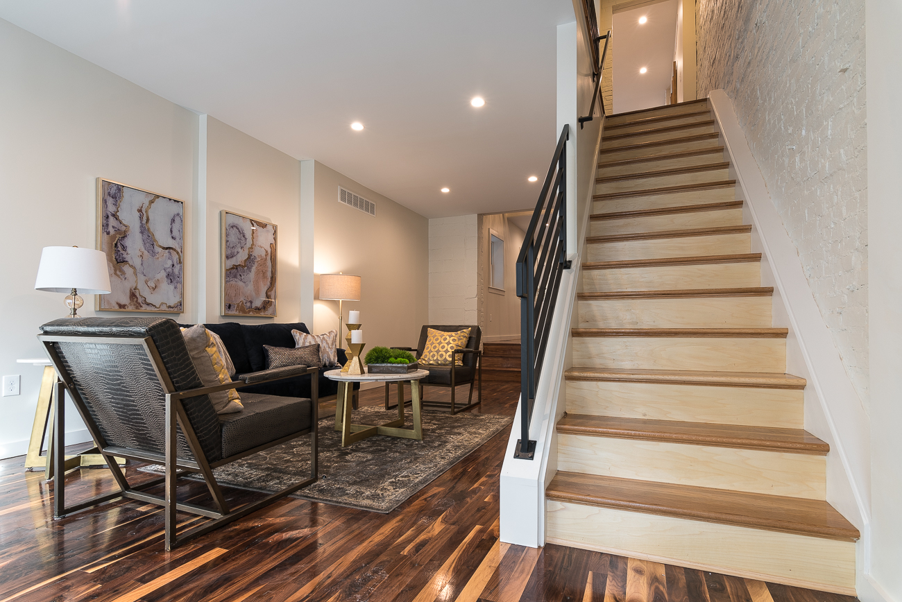 The front door opens to a first floor living room and staircase. 1428 Main Street is listed for $489,000 by Michael Chewning and Seth Maney with Coldwell Banker West Shell. / Image: Phil Armstrong, Cincinnati Refined // Published: 2.17.19