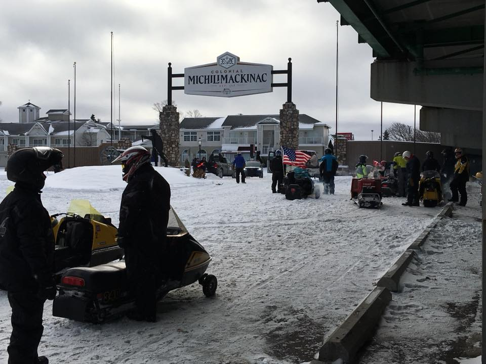 Dozens of antique and vintage snowmobiles crossed The Mighty Mac as part of the 2nd Annual Bridge Crossing. Photo Courtesy: Top of the Lake Snowmobile Museum