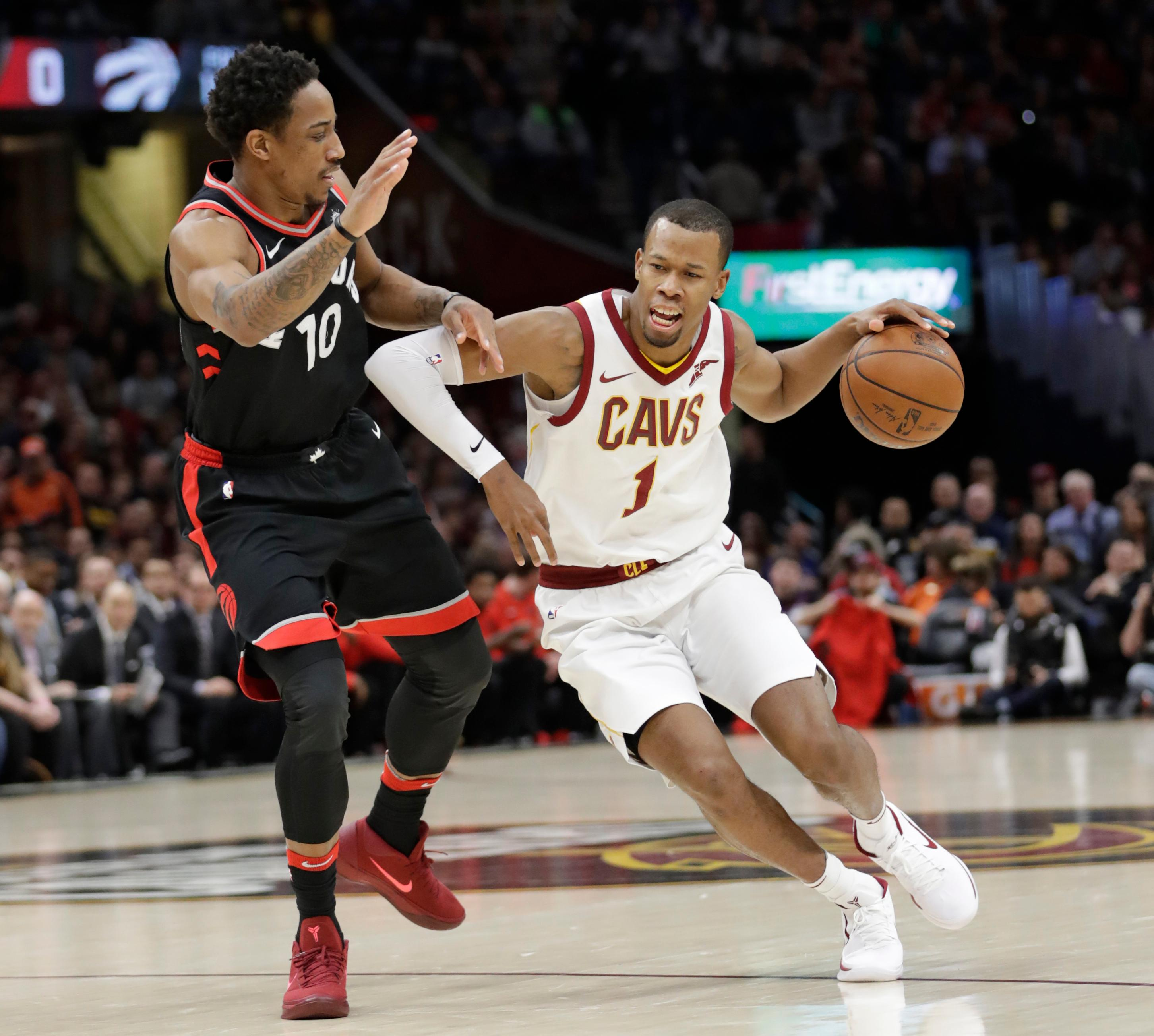 FILE - In this April 3, 2018, file photo, Cleveland Cavaliers' Rodney Hood (1) drives past Toronto Raptors' DeMar DeRozan (10) during the first half of an NBA basketball game in Cleveland. A person familiar with the situation says the Cavaliers will not fine or suspend forward Rodney Hood for refusing to enter Game 4 against Toronto. The Athletic reported that Hood angered his teammates and others in the organization when he declined coach Tyronn Lue's request to replace LeBron James with 7:38 left and the Cavs leading by 30. Hood spoke to team officials about the incident Tuesday, May 8, 2018, and will not be disciplined, said the person who spoke to the Associated Press on condition of anonymity because of sensitivity.(AP Photo/Tony Dejak, File)