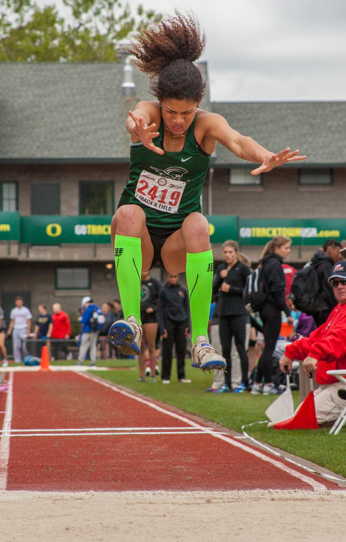 Taylor McCarrell from West Salem High School wins the Girls Triple Jump 6A event with the distance of 38-02.25 at the OSAA Track and Field State Championships at Hayward Field. Photo by Vannie Cooper, Oregon News Lab