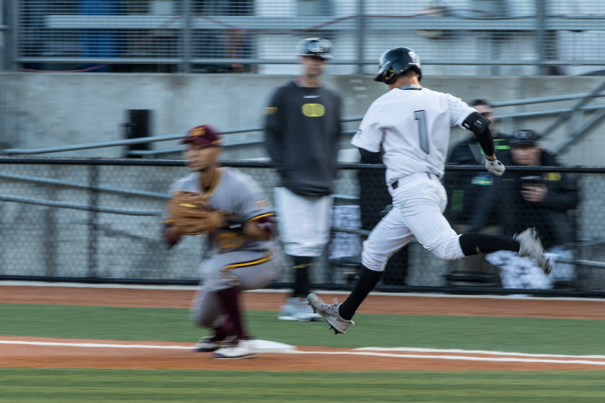 Oregon Ducks infielder Kyle Kasser (#1) steps onto first base seconds before the ball arrived. The Oregon Ducks defeated the Arizona State Sun Devils 2-0 in the first game of a three game series Friday evening at PK Park in Eugene, Oregon.  Photo by Austin Hicks, Oregon News Lab