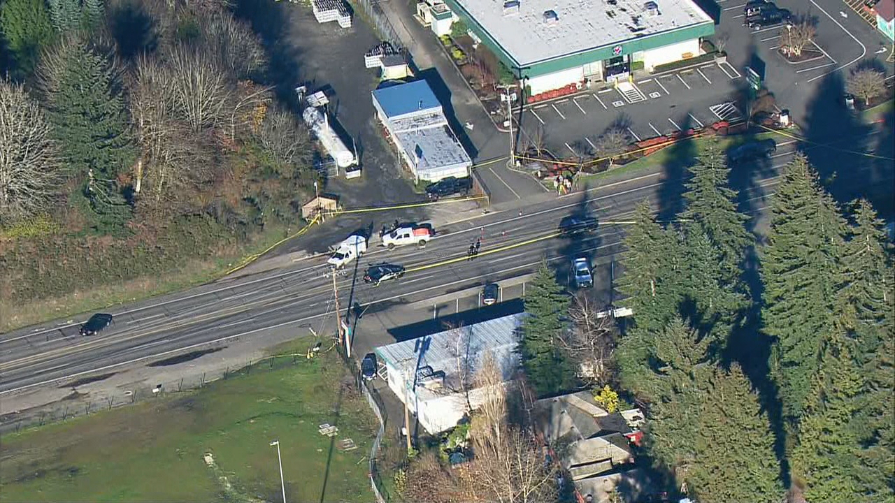 Police respond to the accident scene on Martin Way East in Olympia. (KOMO News/Air 4 photo)