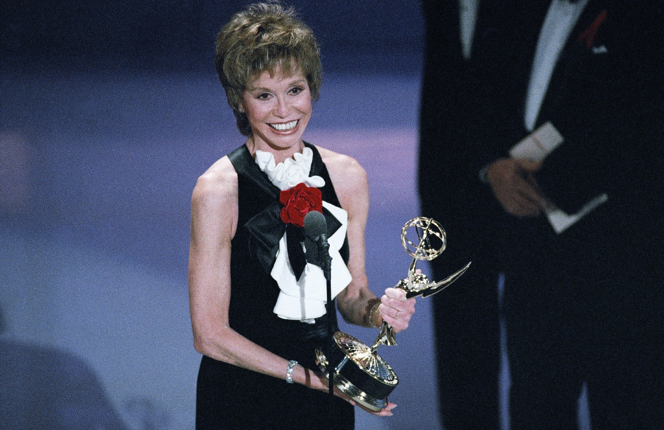 Mary Tyler Moore, 56, accepts the Emmy for best supporting actress in a miniseries or special for her role in ?Stolen Babies? during the 45th annual Emmy Awards in Pasadena, California, Sunday, Sept. 19, 1993. Moore wrote a new chapter in Emmy history by winning her seventh career trophy, tying the leading Emmy acting talks with Ed Asner. (AP Photo/Nick Ut)