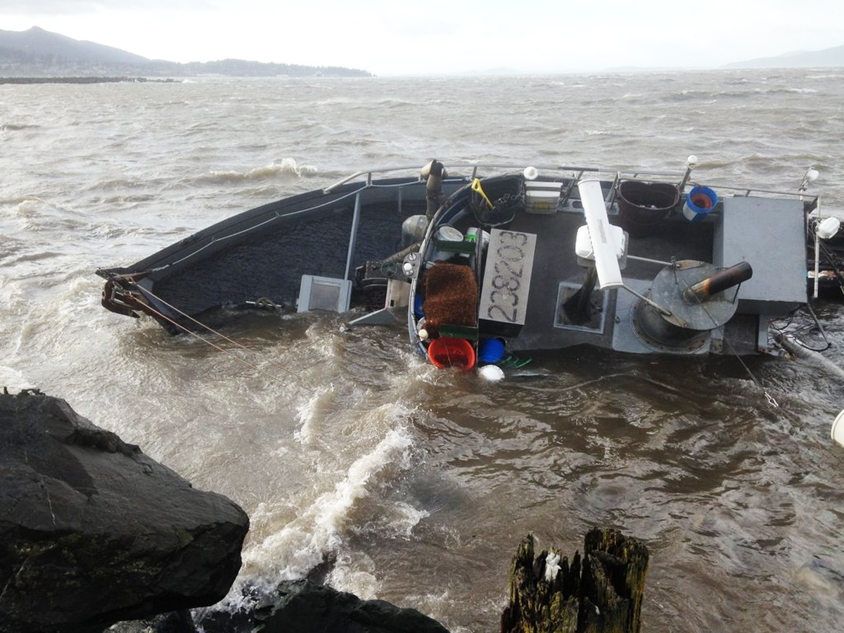 High winds smash a fishing boat against the rocks in Bellingham Bay. 3 people were rescued by the Coast Guard. (Photo courtesy of Ecology NW)