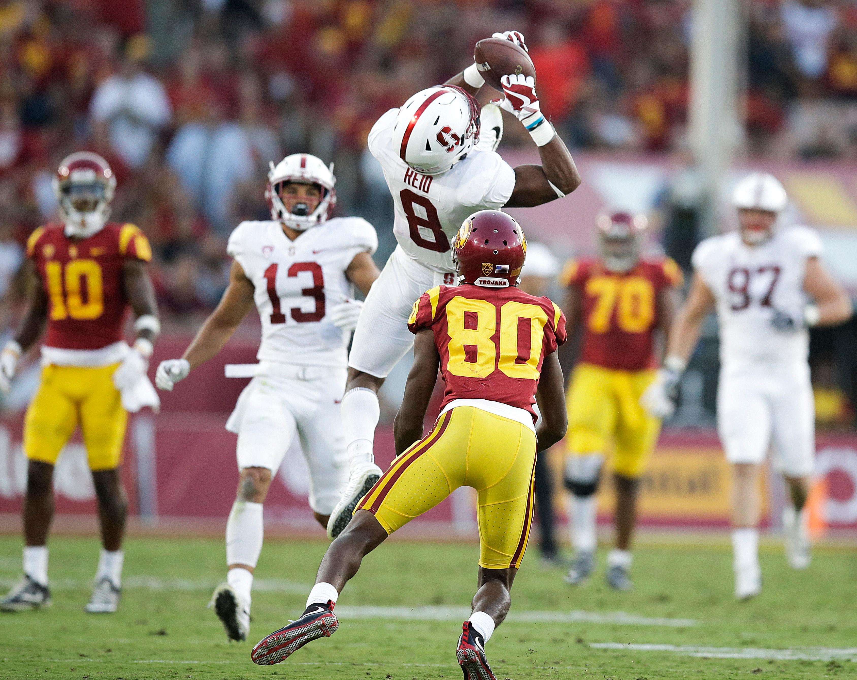 FILE - In this Sept. 9, 2017, file photo, Stanford safety Justin Reid, top, intercepts a pass against Southern California wide receiver Deontay Burnett during the first half of an NCAA college football game, in Los Angeles. Reid was selected to the AP All-Conference Pac-12 team announced Thursday, Dec. 7, 2017. (AP Photo/Jae C. Hong, File)