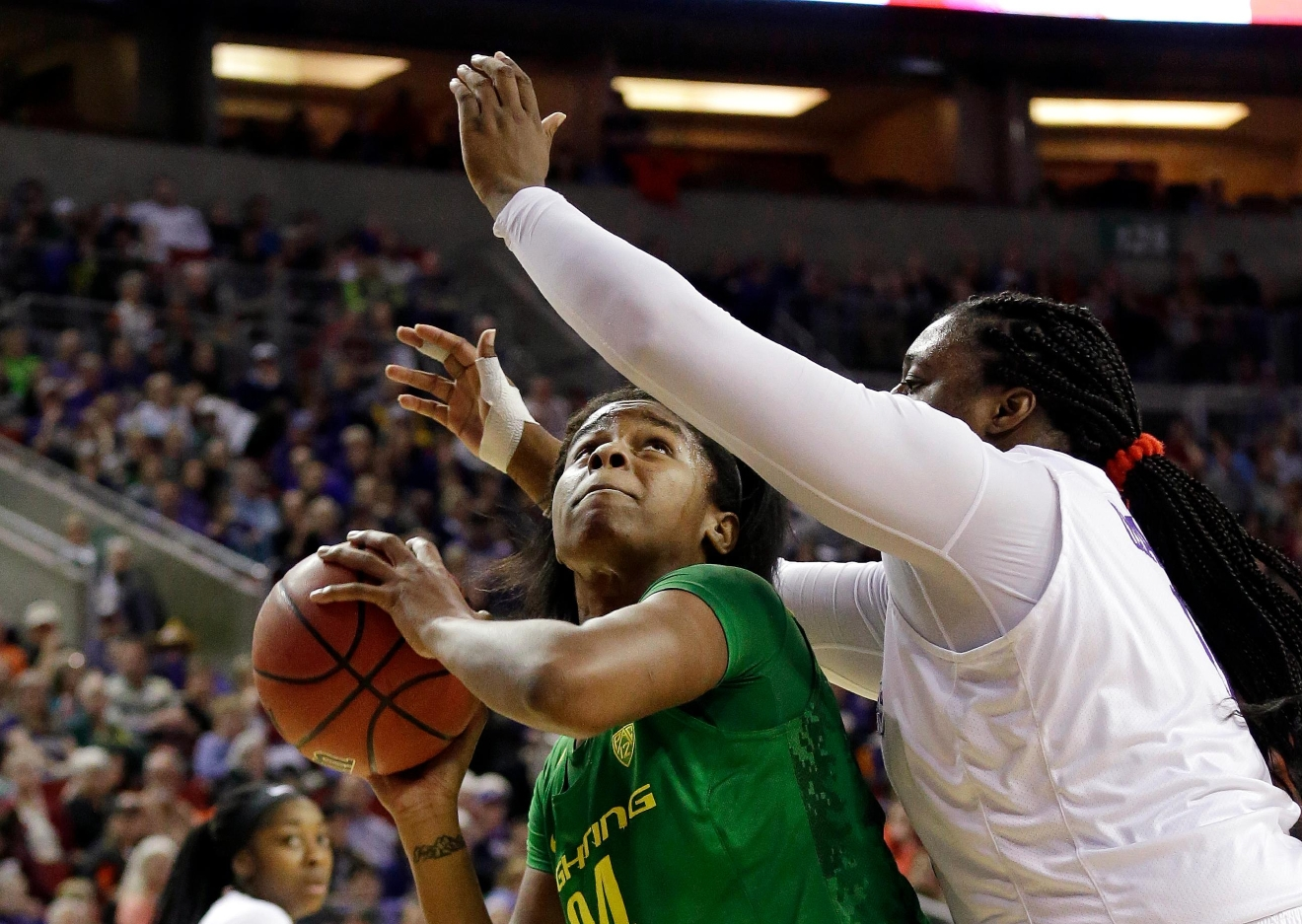 Washington's Chantel Osahor, right, guards Oregon's Ruthy Hebard as Hebard tries to shoot during the first half of an NCAA college basketball game in the Pac-12 Conference tournament, Friday, March 3, 2017, in Seattle. (AP Photo/Elaine Thompson)
