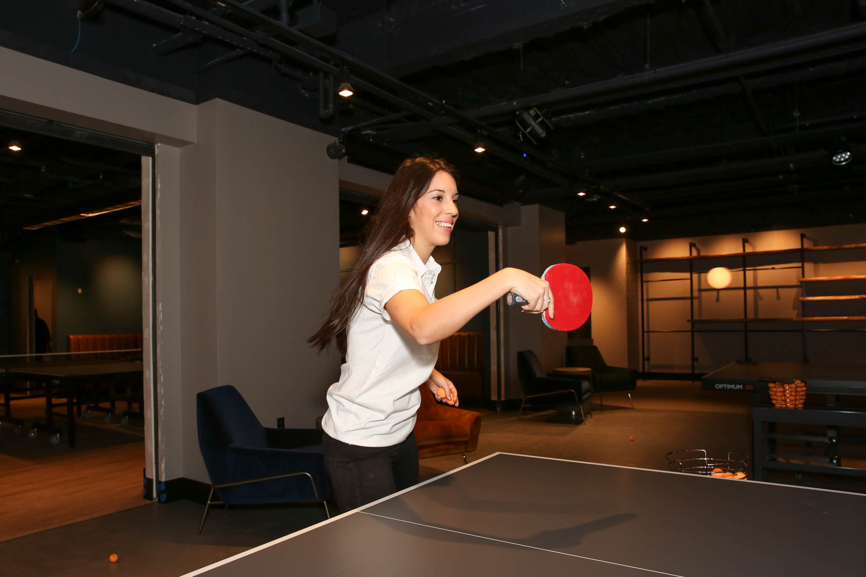 This 14-time Swedish National Ping Pong Champion is gracefully serving as the grand opening manager at D.C.'s Spin location, and will stick around for about six months to oversee operations. But mainly she's here to take you DOWN with her absolutely brutal ping pong skills -- she will challenge you to be able to return her serve, and if you can do it, you win a{ } free game.{ } (Image: Amanda Andrade-Rhoades/ DC Refined)