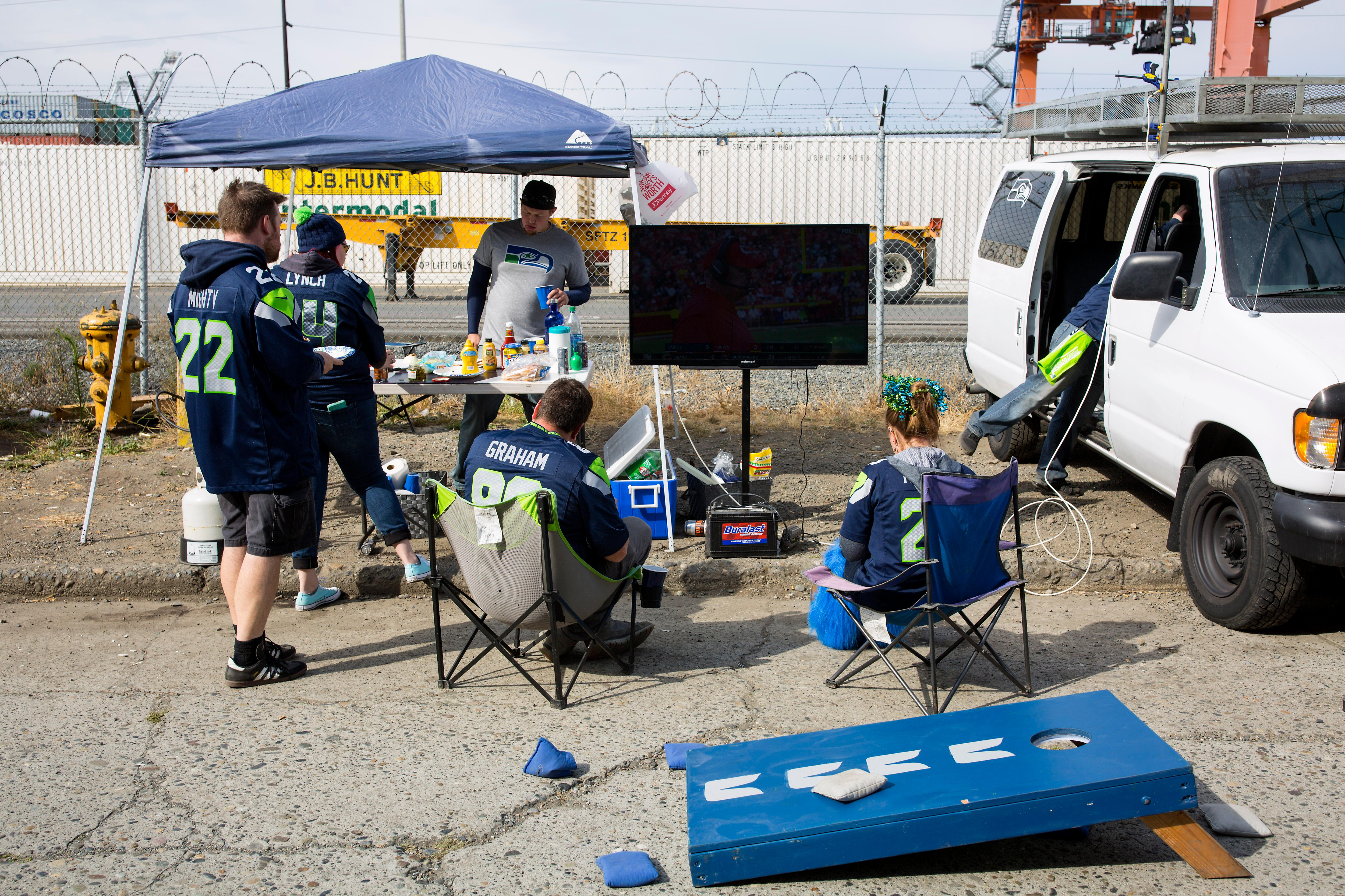 Seahawks fans tailgate and brace for a rainy home game opener as the Seattle Seahawks play the San Francisco 49ers at CenturyLink Field. The score was tied at the half, 6-6. (Sy Bean / Seattle Refined)