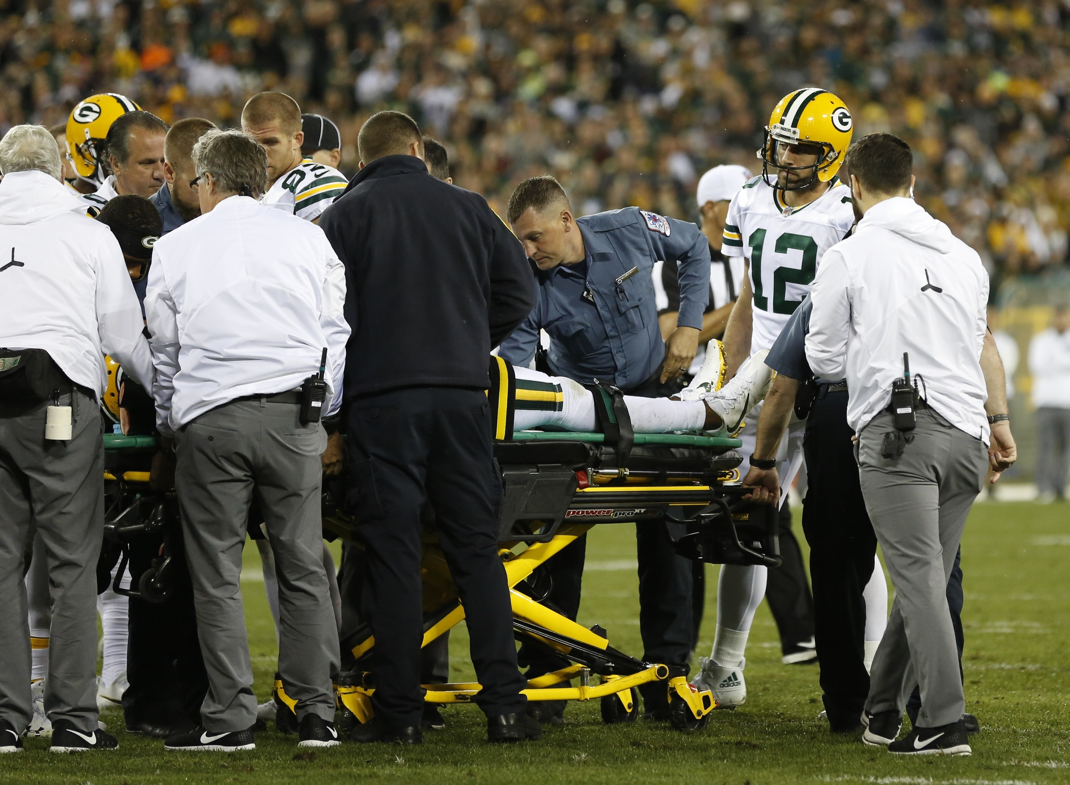 Green Bay Packers' Aaron Rodgers watches as teammate Davante Adams is taken off the field after being hit in the head during the second half of an NFL football game against the Chicago Bears Thursday, Sept. 28, 2017, in Green Bay, Wis. (AP Photo/Matt Ludtke)