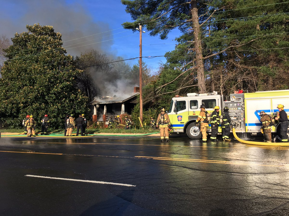 Several crews are working to put out a fire on Tunnel Road in the Swannanoa area (Photo by: WLOS staff)