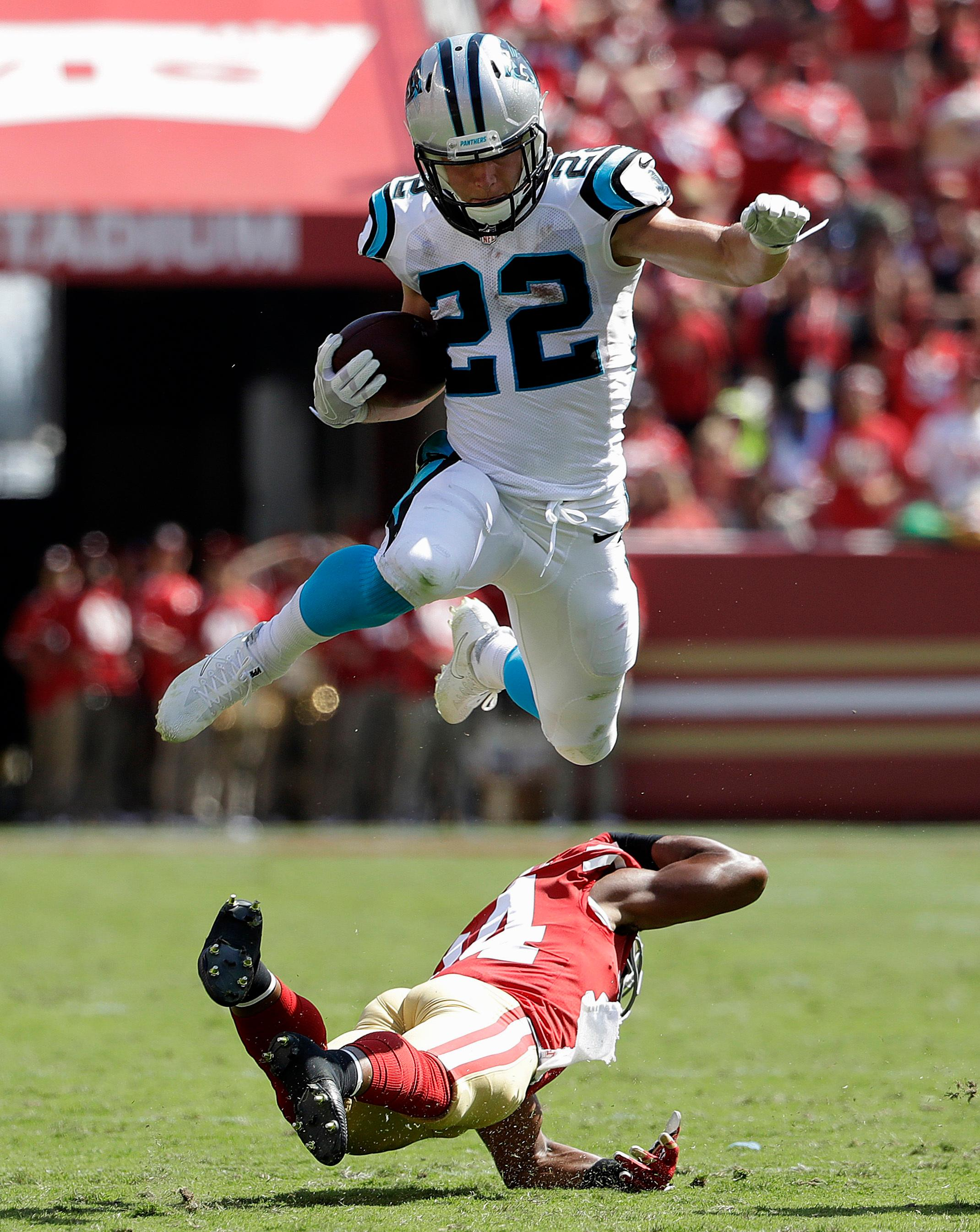 Carolina Panthers running back Christian McCaffrey (22) jumps over San Francisco 49ers defensive back K'Waun Williams (24) during the first half of an NFL football game in Santa Clara, Calif., Sunday, Sept. 10, 2017. (AP Photo/Marcio Jose Sanchez)