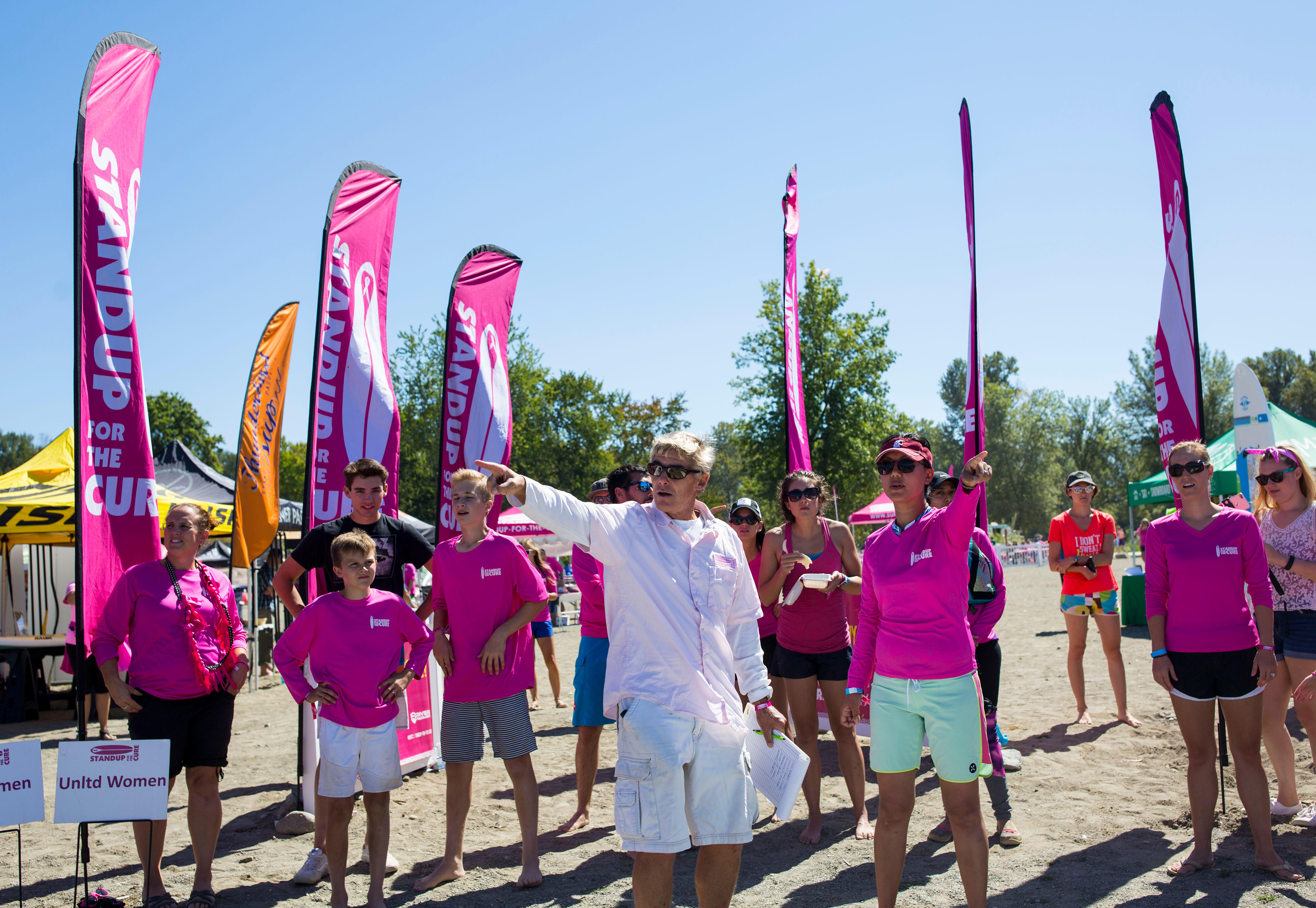 KOMO TV and Seattle Refined hosted Standup for the Cure on Sunset Beach at Lake Sammamish State Park on Saturday, August 26, 2017. Hundreds came out for a day at the lake featuring professional SUP instruction, races, live music, and raffle prizes – all while raising awareness and funds for Susan G. Komen Puget Sound. Attendees chose between hanging out on the lake, staying dry on land (or both!) and enjoyed Barefoot Wine, Mac & Jack's Beer, and Tito's Handmade Vodka in the social garden. Registered participants received a swag bag that with apparel, complimentary lunch from one of the awesome food vendors, a drink ticket and offers from the expo sponsors. Every $125 raised for Komen enables a local uninsured woman to receive a breast exam. (Image: Sy Bean / Seattle Refined)