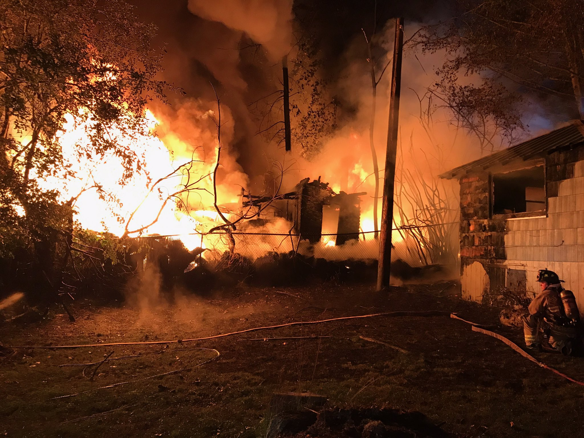 Crews arrived to the scene at about 3:30 a.m. Monday to try to fight a fire burning a tire store and a home along Hwy 99 near Mukilteo Speedway. (Photo credit: South Snohomish Fire)<p></p>