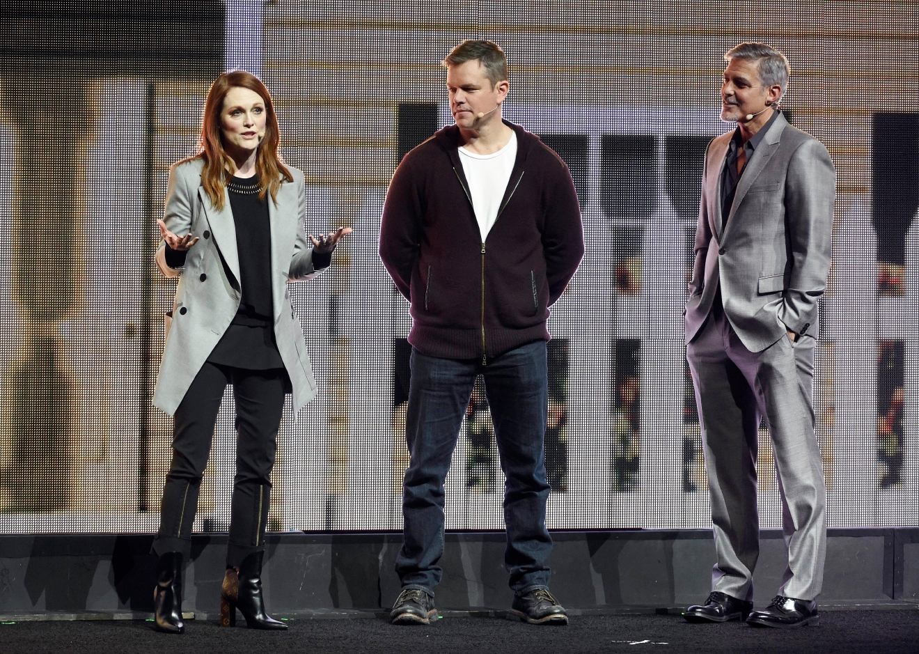"Julianne Moore, left, a cast member in the upcoming film ""Suburbicon,"" addresses the audience as fellow cast member Matt Damon, center, and director George Clooney look on during the Paramount Pictures presentation at CinemaCon 2017 at Caesars Palace on Tuesday, March 28, 2017, in Las Vegas. (Photo by Chris Pizzello/Invision/AP)"