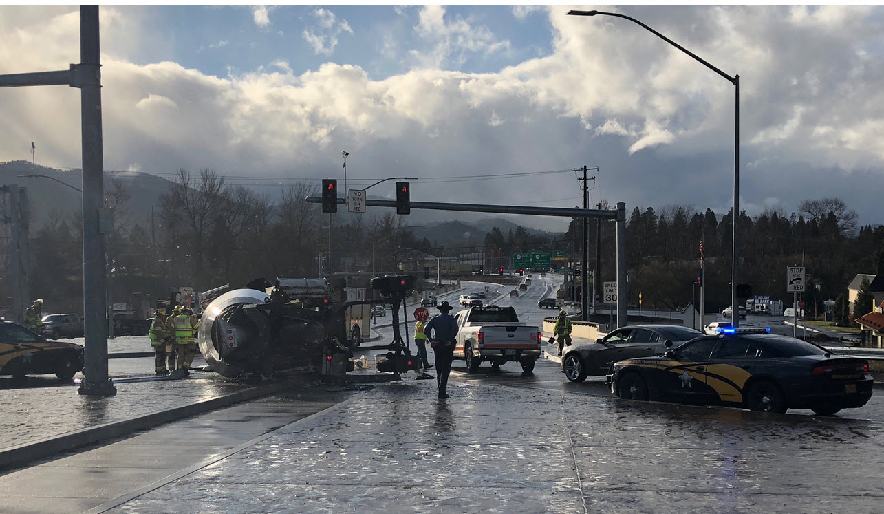A concrete truck overturned at the southbound off-ramp at North Phoenix Road, blocking westbound traffic across the interstate Thursday afternoon. Interstate 5 traffic not affected. Motorists should use alternate routes and expect delays as tow trucks work to move the truck.  (ODOT)