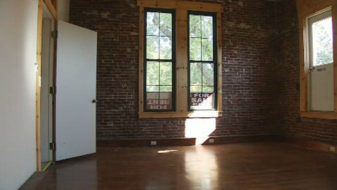 Some rooms in the front of the building are rent-ready, with large wooden beams and exposed brick walls. (WGME)