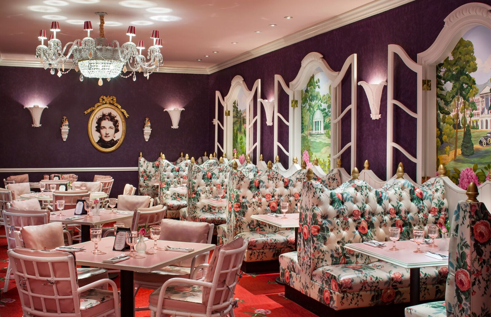 One of the dining options, Draper's, pays tribute to interior decorator Dorothy Draper, who is pictured on the wall.{ }(Image: Courtesy The Greenbrier)