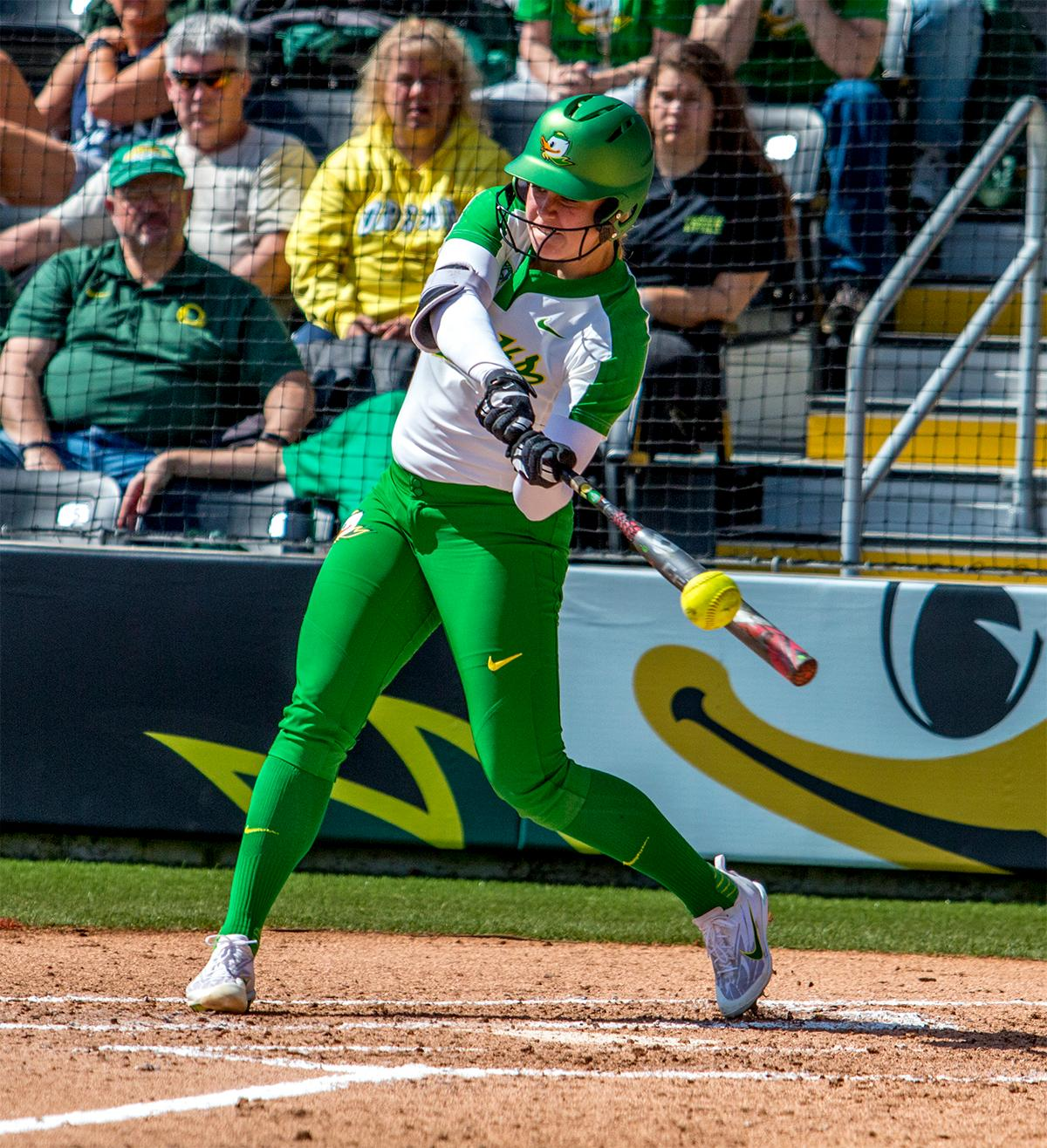 The Duck's Miranda Elish (#40) swings for the ball. The Oregon Ducks Softball team took their third win over the Arizona Sun Devils, 1-0, in the final game of the weekends series that saw the game go into an eighth inning before the Duck?s Mia Camuso (#7) scored a hit allowing teammate Haley Cruse (#26) to run into home plate for a point. The Ducks are now 33-0 this season and will next play a double header against Portland State on Tuesday, April 4 at Jane Sanders Stadium. Photo by August Frank, Oregon News Lab