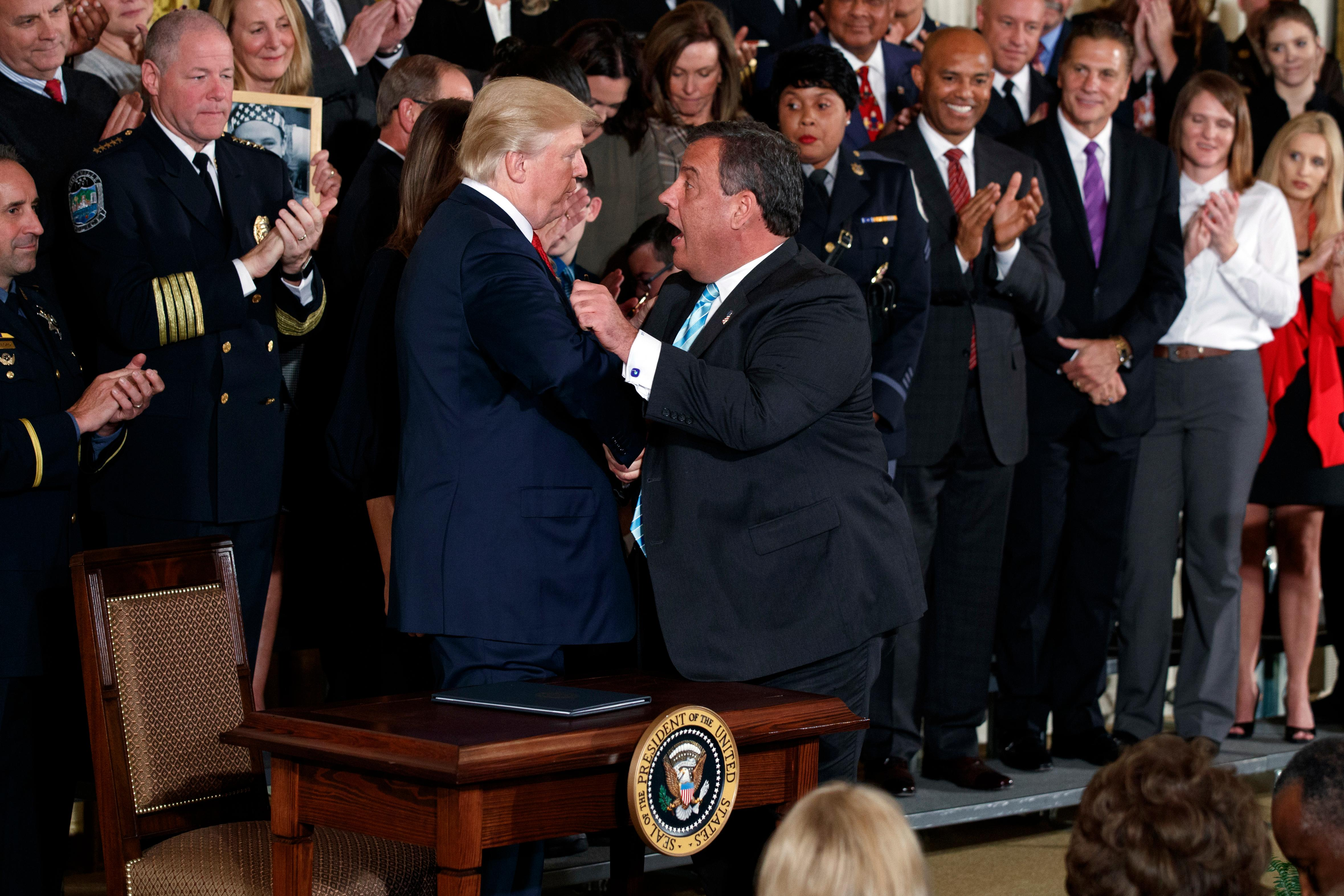 President Donald Trump shakes hands with New Jersey Gov. Chris Christie after signing a presidential memorandum to declare the opioid crisis a national public health emergency in the East Room of the White House, Thursday, Oct. 26, 2017, in Washington. (AP Photo/Evan Vucci)