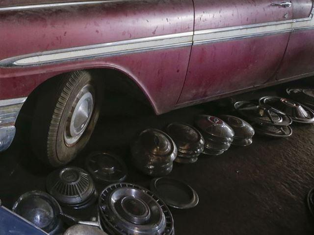 Sold along with the old Chevys from the former Lambrecht dealership is variety of parts and memorabilia, such as this pile of old wheel covers.