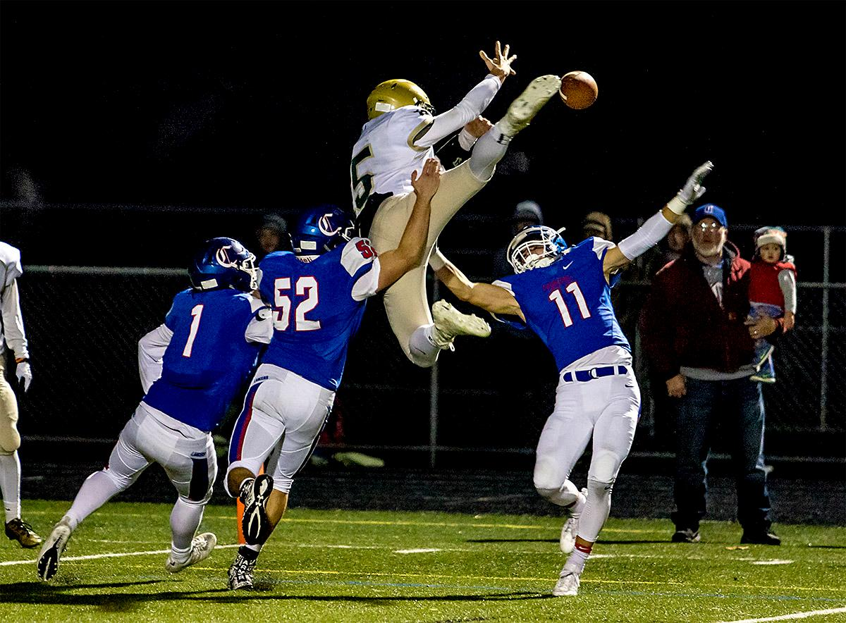 The Buckaroos' Jon Swaggart (#5) flies up into the air as the Lancers bring his run to a stop. The Churchill Lancers defeated the Pendleton Buckaroos 42-15, in the first round of the state 5A playoffs. Photo by August Frank, Oregon News Lab