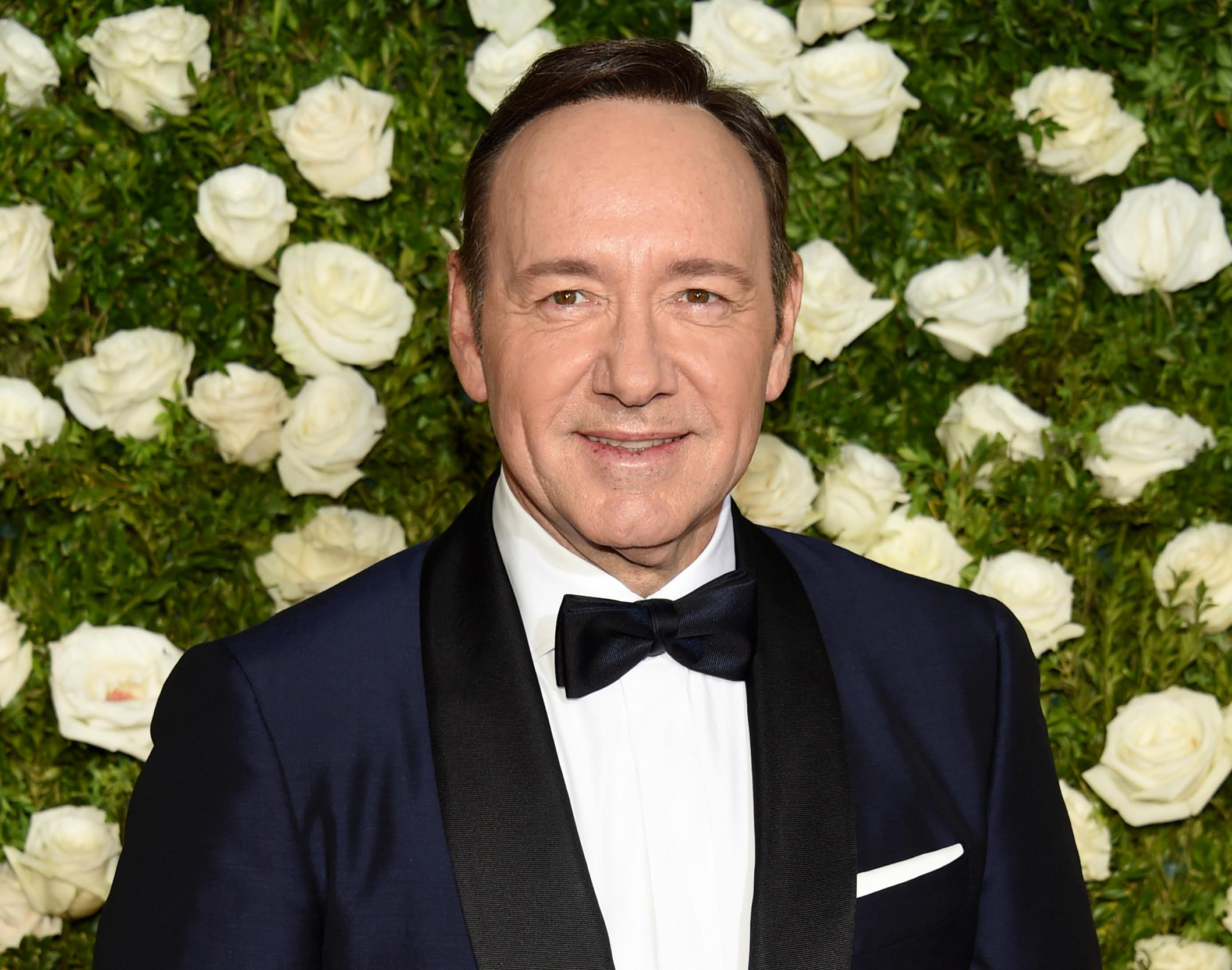 "FILE - In this June 11, 2017 file photo, Kevin Spacey arrives at the 71st annual Tony Awards at Radio City Music Hall in New York. The sexual harassment and assault allegations against Harvey Weinstein that rocked Hollywood and sparked a flurry of allegations in other American industries, as well as the political arena, are reaching far beyond U.S. borders. Emboldened by the women, and men, who have spoken up, the ""Weinstein Effect"" is rippling across the globe. London was for many years a base for actor Spacey, who served as artistic director of the Old Vic theater from 2004 until 2015. The allegations of sexual harassment that have surfaced in recent weeks, including some during his tenure at the Old Vic, have cast a pall over his tenure. (Photo by Evan Agostini/Invision/AP, File)"