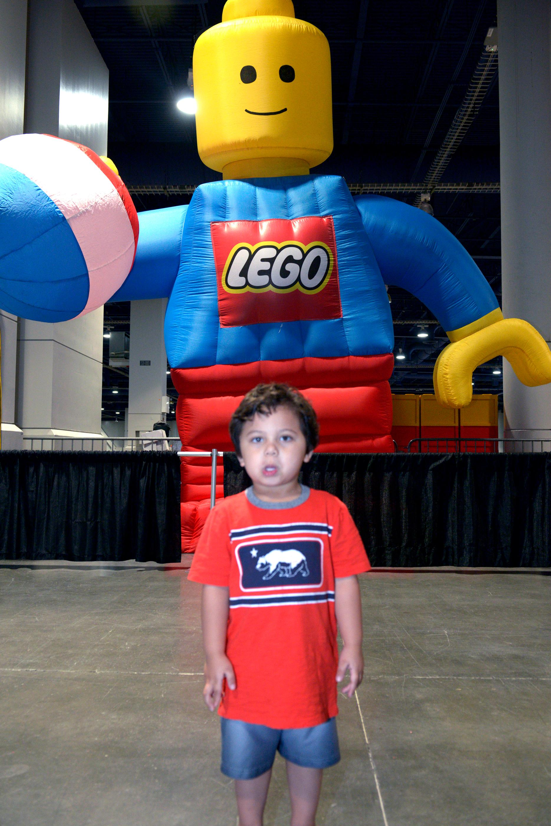 3 Year-old Preston Stoker is a little apprehensive about the 20 ft. tall Lego man behind him during the Brick Fest Live Lego Fan Experience at the Las Vegas Convention Center, September 9, 2017. [Glenn Pinkerton/Las Vegas News Bureau]