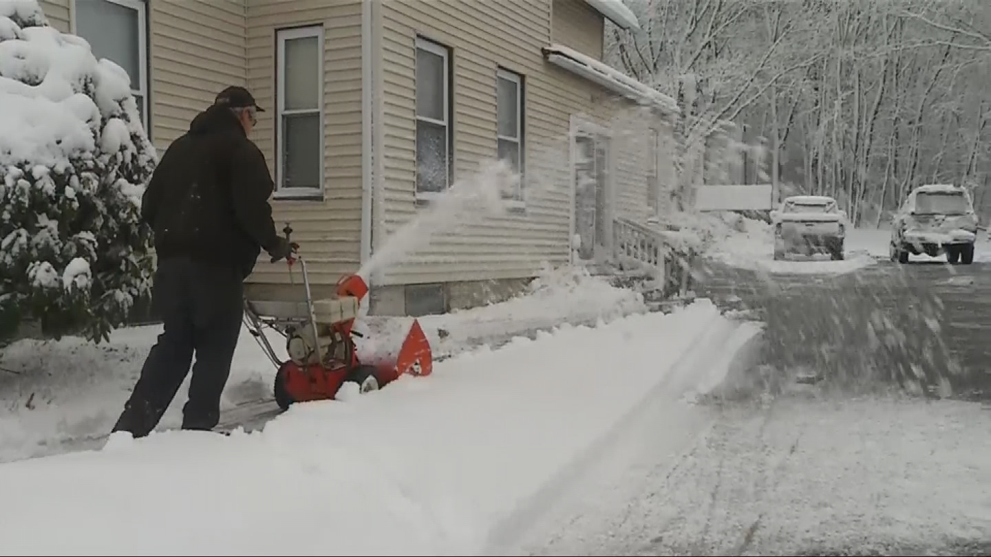 A man clears his driveway in Burrillville, Thursday, March 8, 2018. (WJAR)