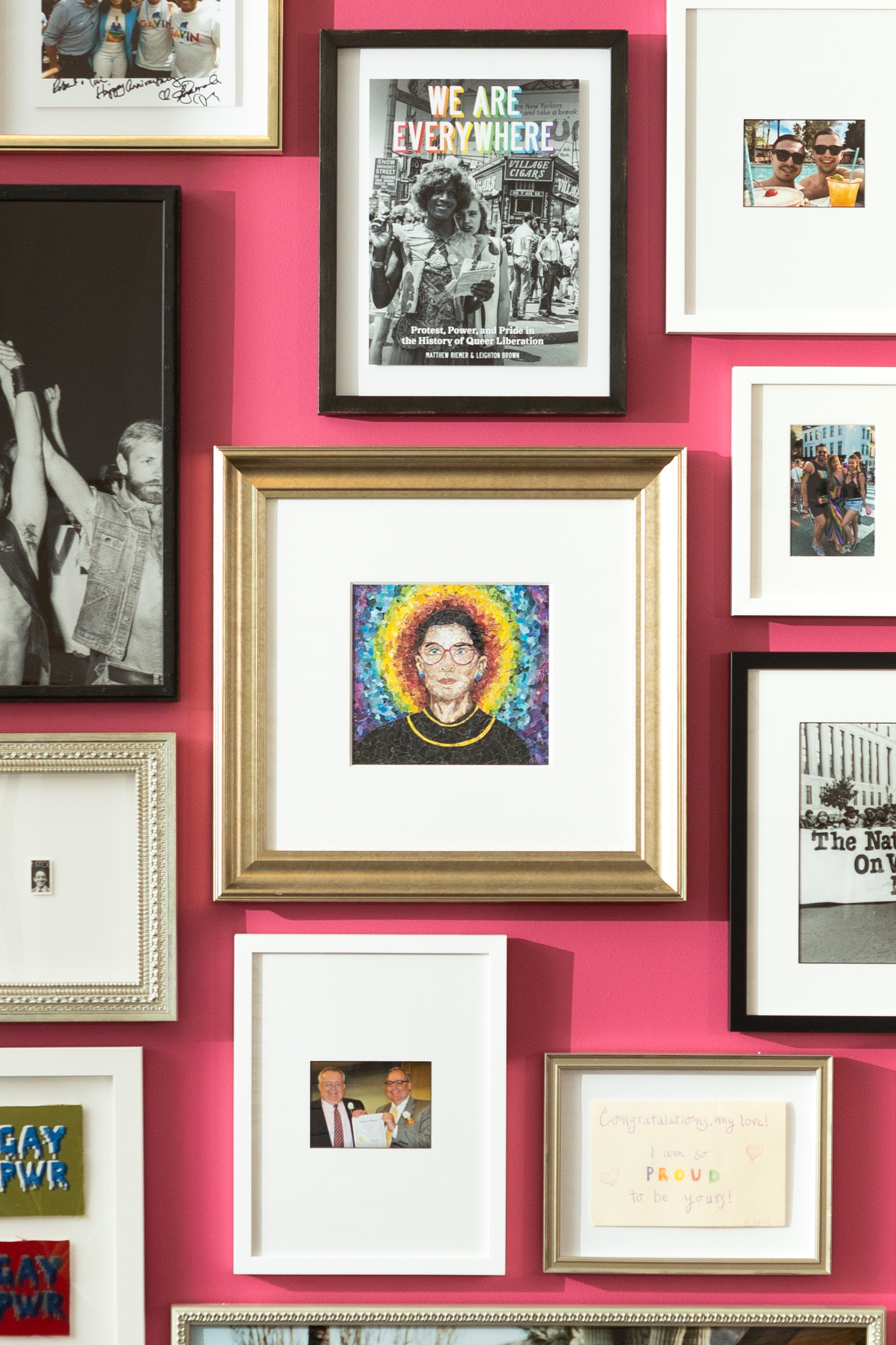 The wall features 60 photos and mementos that highlight personal stories of love, compassion, and the fight for equality. (Image: Courtesy Framebridge)