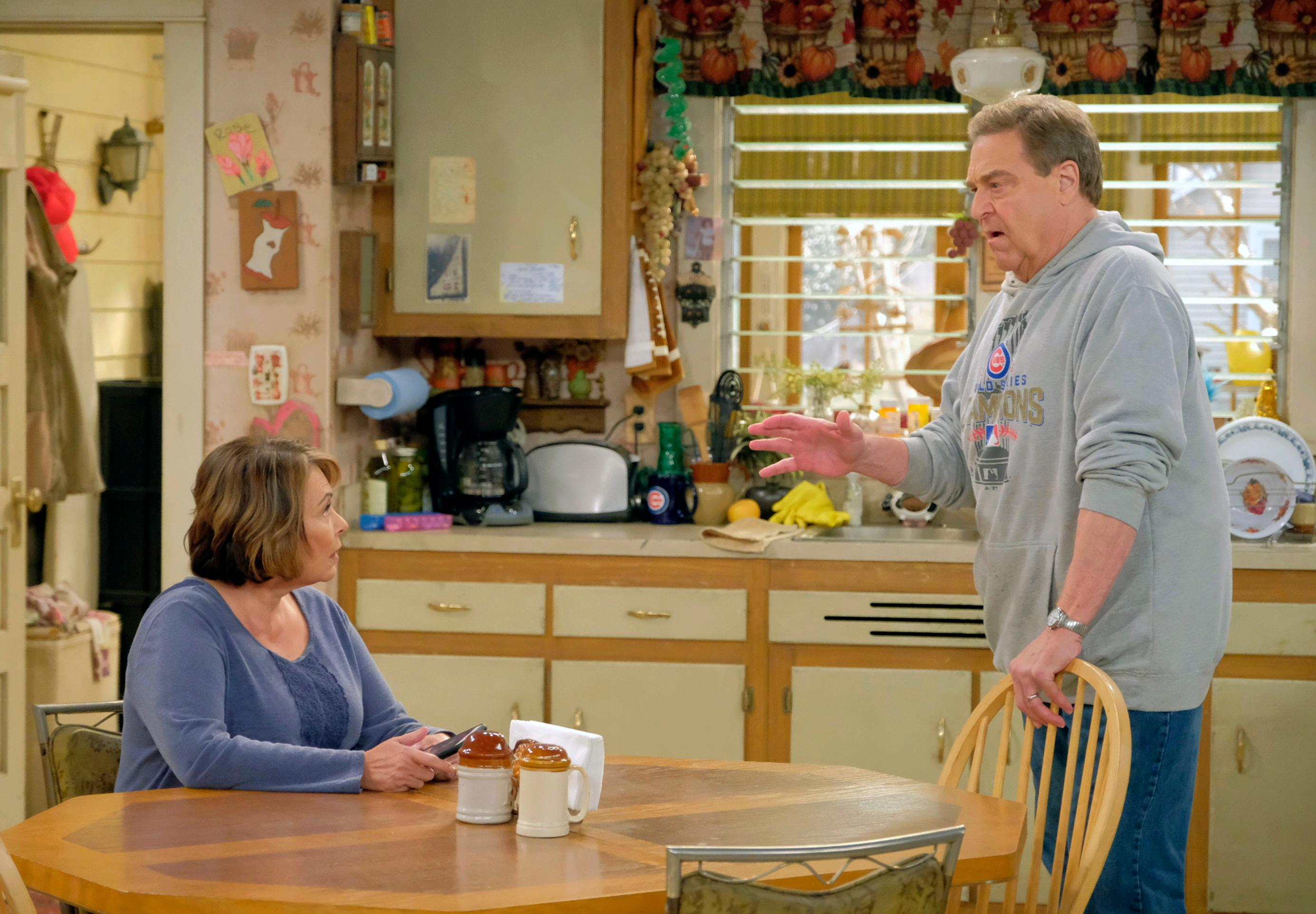 "This image released by ABC shows Roseanne Barr, left, and John Goodman in a scene from ""Roseanne."" The audience for the second week of ABC's ""Roseanne"" reboot was down, but not by much. The Nielsen company said that 15.2 million people watched the show on Tuesday night. (Adam Rose/ABC via AP)"
