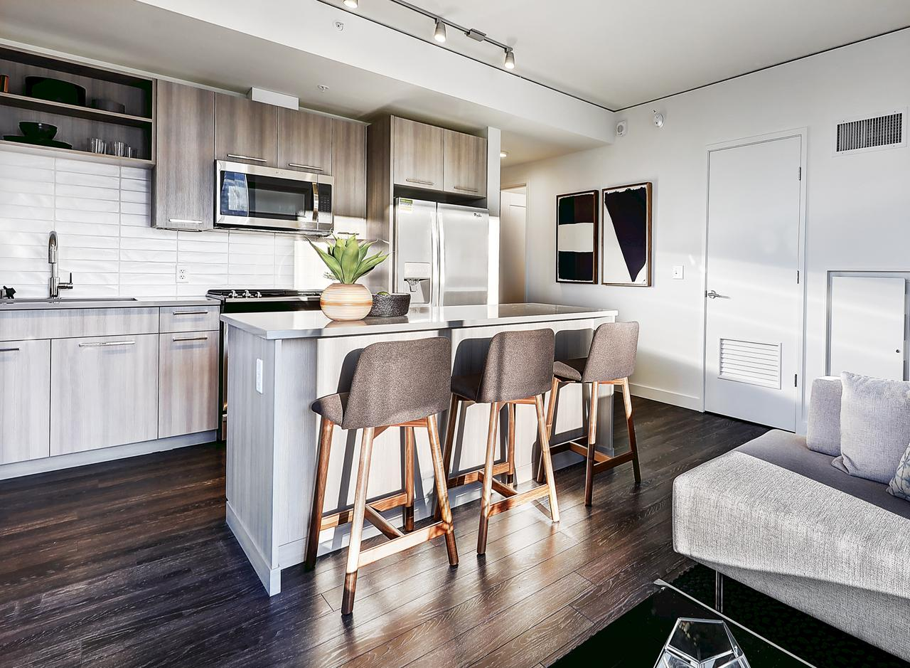 The kitchen in a two bedroom apartment at AMLI Arc