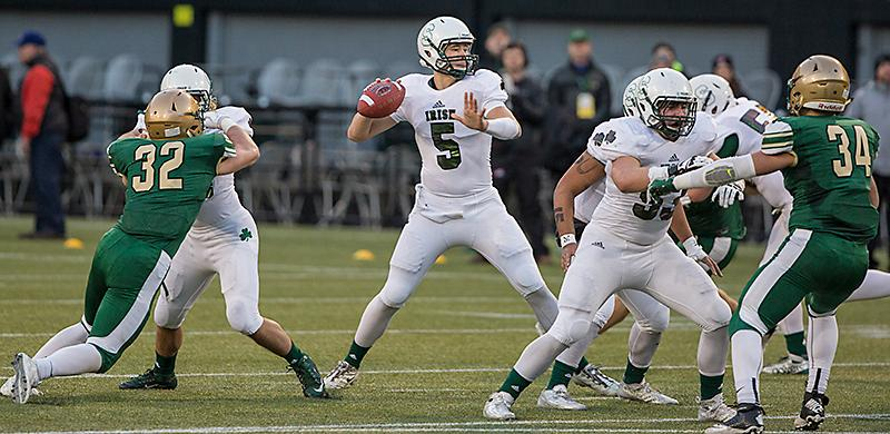 Sheldon quarterback Justin Herbert (#5) looks to throw the ball downfield. With a 34-13 win over Sheldon, Jesuit advances to the OSAA 6A Football State Championship versus West Linn.