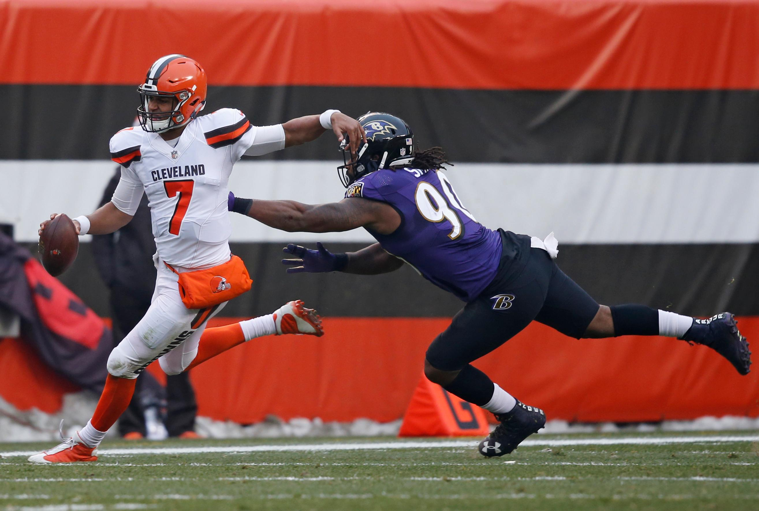 Cleveland Browns quarterback DeShone Kizer (7) tries to avoid Baltimore Ravens defensive end Za'Darius Smith (90) during the second half of an NFL football game, Sunday, Dec. 17, 2017, in Cleveland. (AP Photo/Ron Schwane)