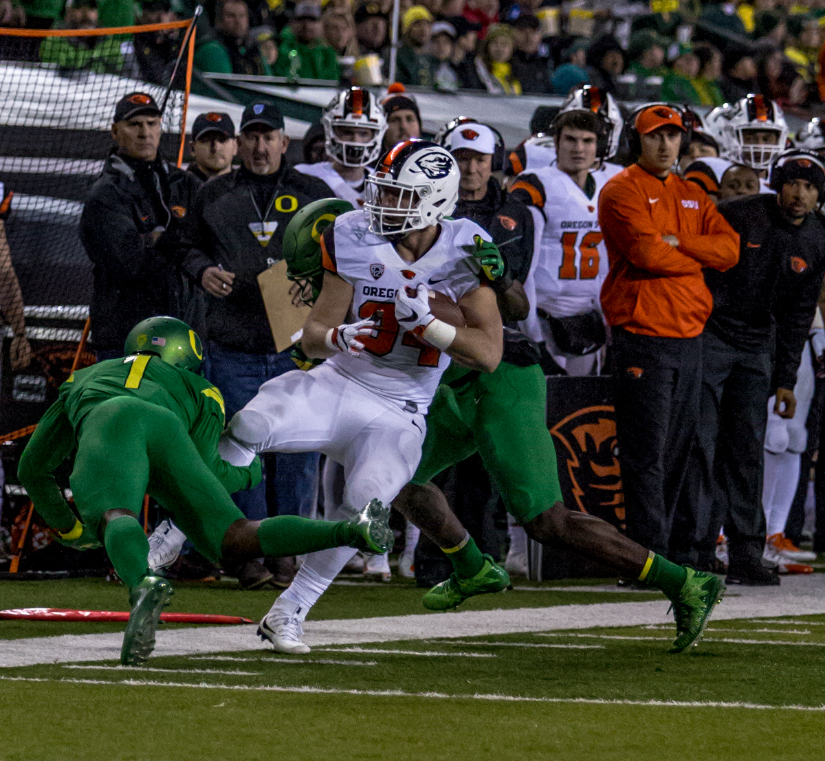 Oregon defensive players take down Oregon State running back Ryan Nall (#34). The Oregon Ducks lead the Oregon State Beavers 52 to 7 at the end of the first half of the 121st Civil War game on Saturday, November 25, 2017 at Autzen Stadium in Eugene, Ore. Photo by Ben Lonergan, Oregon News Lab
