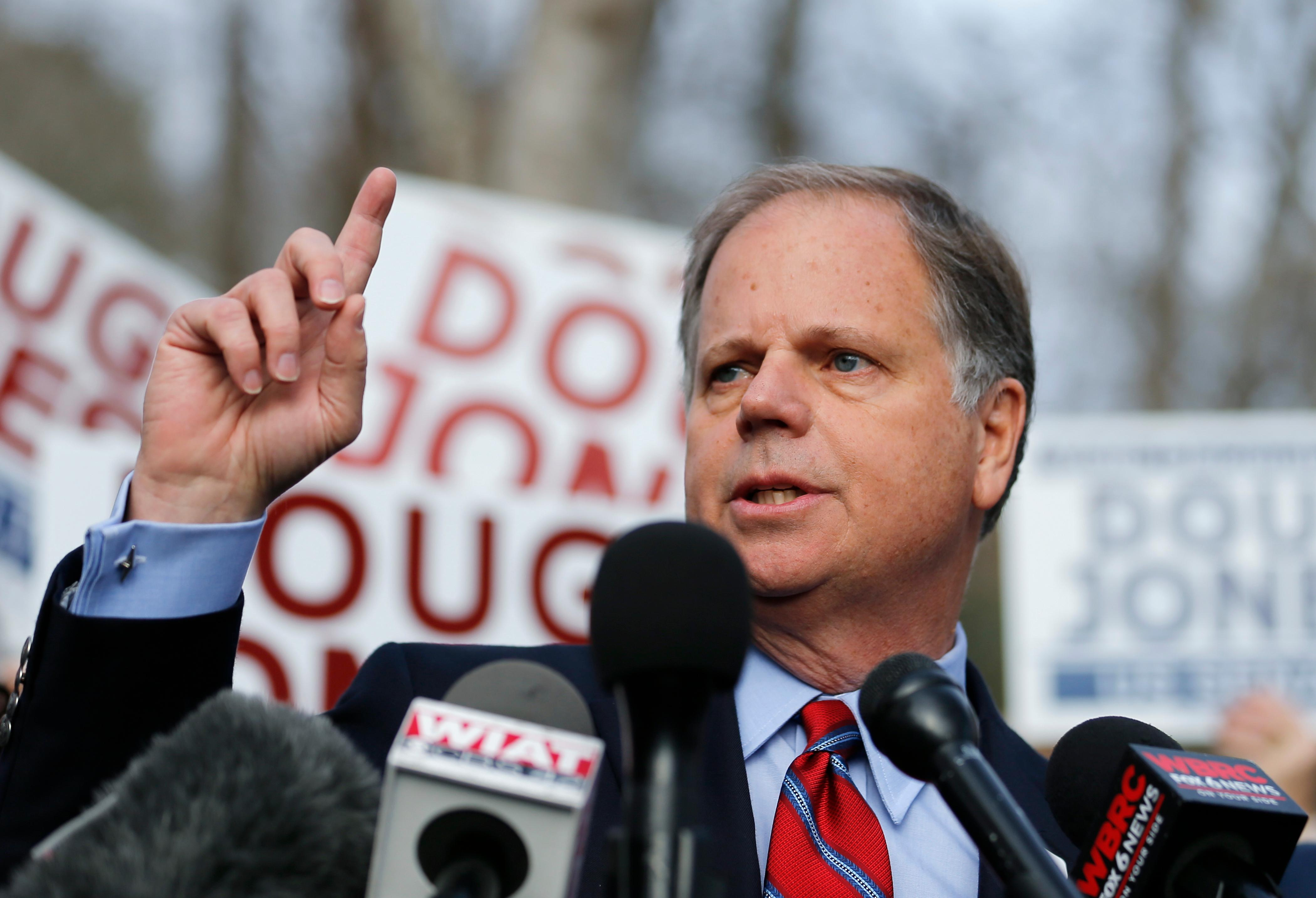 Democratic candidate for U.S. Senate Doug Jones speaks to reporters after casting his ballot Tuesday, Dec. 12, 2017, in Mountain Brook , Ala.  Jones is facing Republican Roy Moore. (AP Photo/John Bazemore)