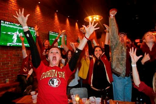 Florida State fans react to a play as they watch the fourth quarter of NCAA BCS National Championship college football game against Auburn at Madison Social bar on Monday, Jan. 6, 2014, in Tallahassee, Fla.