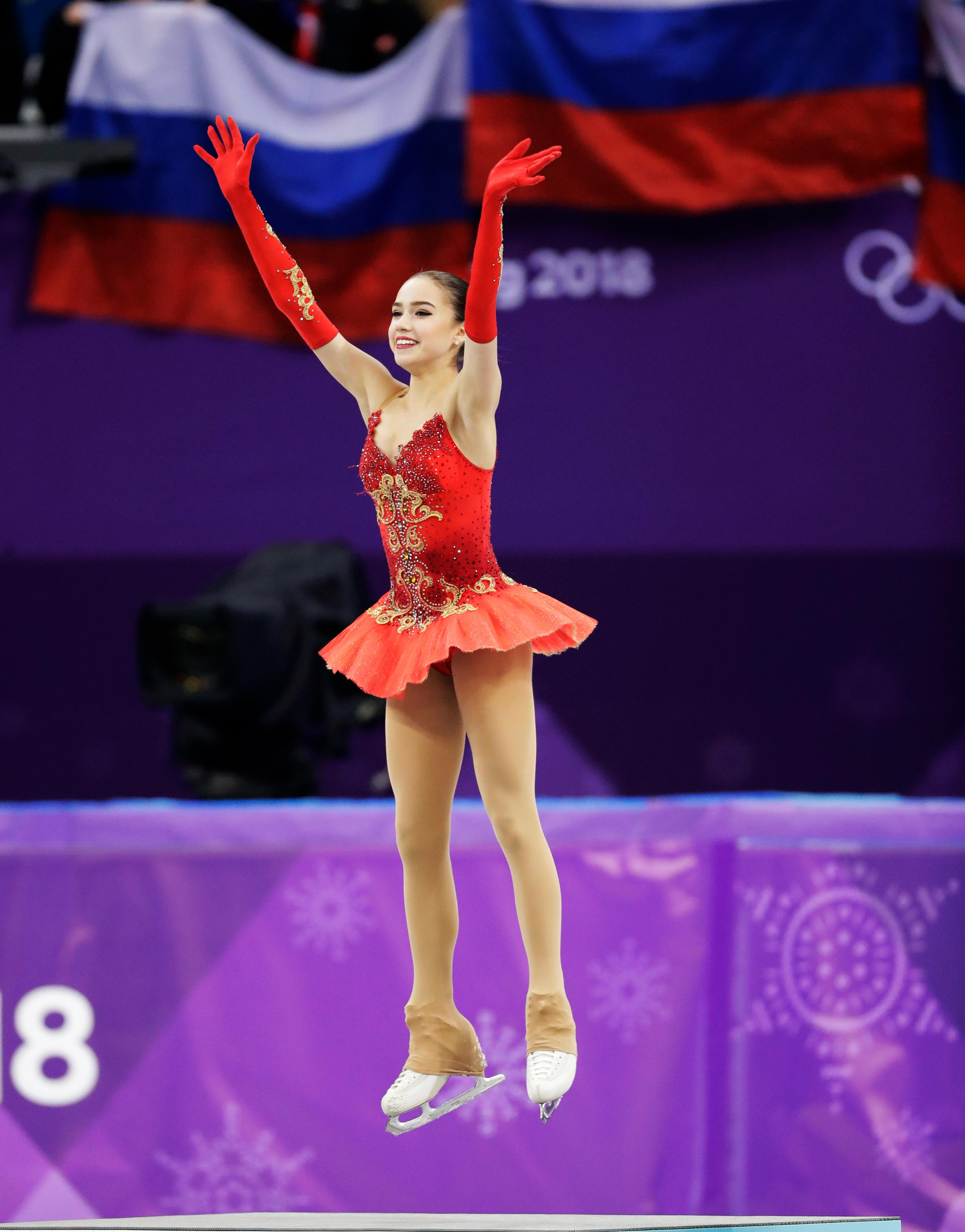 Alina Zagitova of the Olympic Athletes of Russia celebrates on the podium after winning the gold medal in the women's free figure skating final in the Gangneung Ice Arena at the 2018 Winter Olympics in Gangneung, South Korea, Friday, Feb. 23, 2018. (AP Photo/Bernat Armangue)