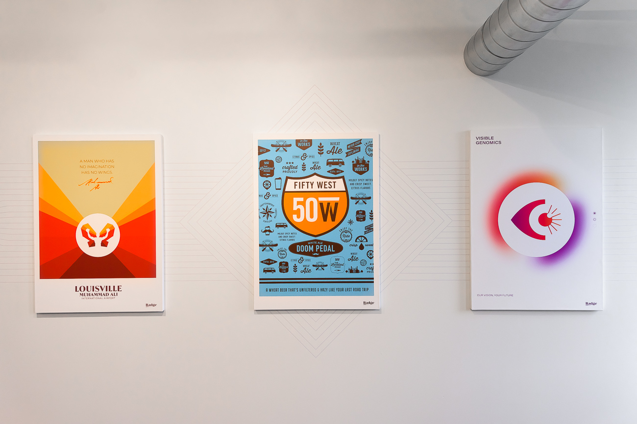 Examples of the work from Badge's portfolio hang on the walls of the new office space. The canvases help break up the minimalism of the remodeled space, but don't merely hang for aesthetic; they showcase what the firm has done. / Image: Phil Armstrong, Cincinnati Refined // Published: 9.5.19