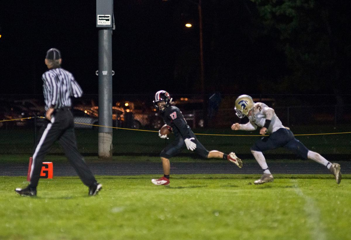 Thurston Colts wide receiver Dylan Averill (#17) sprints into the end zone for a score against the Marist Spartans. Thurston defeated Marist 50 to 14 to seal the second position in their conference. Photo by Dan Morrison, Oregon News Lab