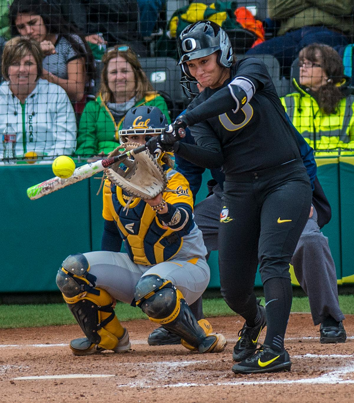 Oregon Ducks Shannon Rhodes (#9) swings at the ball. The Oregon Ducks defeated the Cal Bears 2-1 in game two of a three-game series. Photo by Rhianna Gelhart, Oregon News Lab